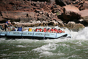 Raft going through rapids Colorado River Grand Canyon ArizonaThe Grand Canyon, Arizona.Rafting, Colorado River, The Grand Canyon, Arizona.Rafting, Colorado River, The Grand Canyon, Arizona.