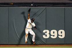 SAN FRANCISCO, CA - APRIL 18: Denard Span #2 of the San Francisco Giants leaps for but is unable to catch a fly ball hit for a home run by Welington Castillo (not pictured) of the Arizona Diamondbacks during the fourth inning at AT&T Park on April 18, 2016 in San Francisco, California. The Arizona Diamondbacks defeated the San Francisco Giants 9-7 in 11 innings.  (Photo by Jason O. Watson/Getty Images) *** Local Caption *** Denard Span