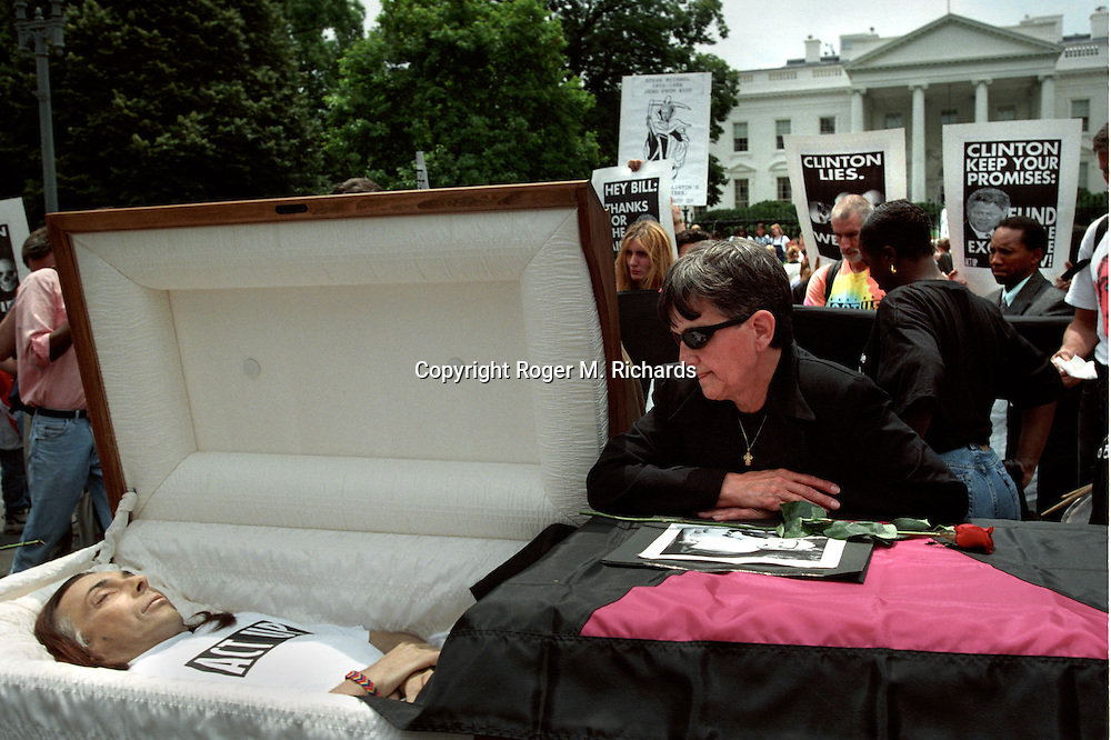 The body of an AIDS activist is paraded in front of the White House as part of a protest against the Clinton administration's AIDS policies, June 4, 1998. (Photo by Roger M. Richards)