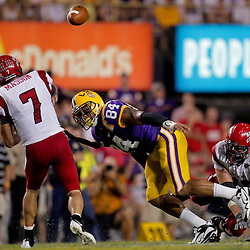 19 September 2009: LSU Tigers defensive end Rahim Alem (84) pressures Louisiana-Lafayette Cajuns quarterback Chris Masson (7) during a 31-3 win by the LSU Tigers over the University of Louisiana-Lafayette Ragin Cajuns at Tiger Stadium in Baton Rouge, Louisiana.