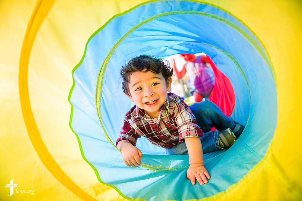 Xavier climbs through a play tunnel at ACTS of Love Early Childhood Education Center on Tuesday, Nov. 15, 2016, in Leander, Texas. LCMS Communications/Erik M. Lunsford