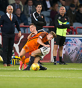 August 9th 2017, Dens Park, Dundee, Scotland; Scottish League Cup Second Round; Dundee versus Dundee United; Dundee's Cammy Kerr tackles Dundee United's Billy King