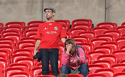 A Barnsley supporter is visibly upset after seeing the crowd trouble between Millwall and Barnsley supporters - Mandatory by-line: Robbie Stephenson/JMP - 29/05/2016 - FOOTBALL - Wembley Stadium - London, England - Barnsley v Millwall - Sky Bet League One Play-off Final