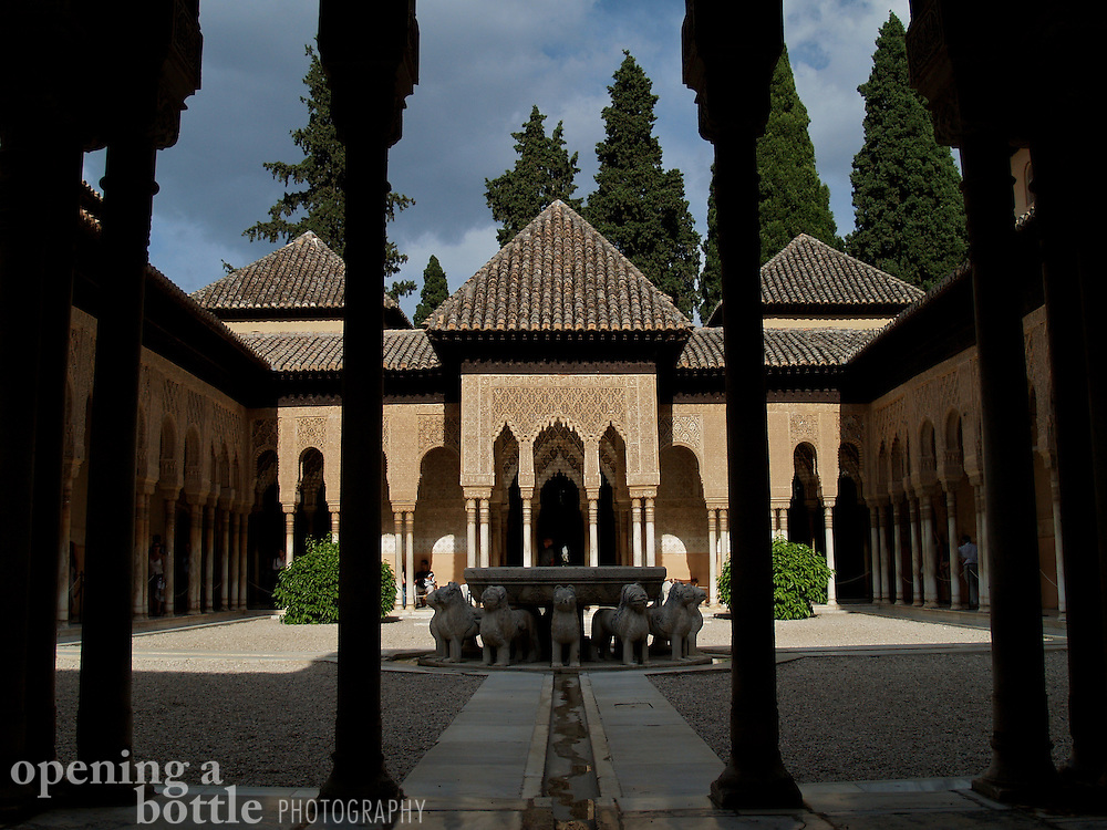 Overview of the Courtyard of Lions inside Palacios Nazaries, The Alhambra, Granada (Andalusia), Spain.