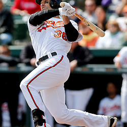 Mar 3, 2013; Sarasota, FL, USA; Baltimore Orioles first baseman Conor Jackson (36) hits a solo homerun against the Philadelphia Phillies during the bottom of the first inning of a spring training game at Ed Smith Stadium. Mandatory Credit: Derick E. Hingle-USA TODAY Sports