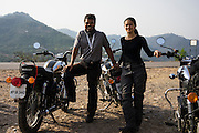 Suzanne Lee and Sanjit Das stop for lunch while climbing the hills towards Jammu during their motorcycle ride Across the Indian Himalayas on Royal Enfield motorcycles.