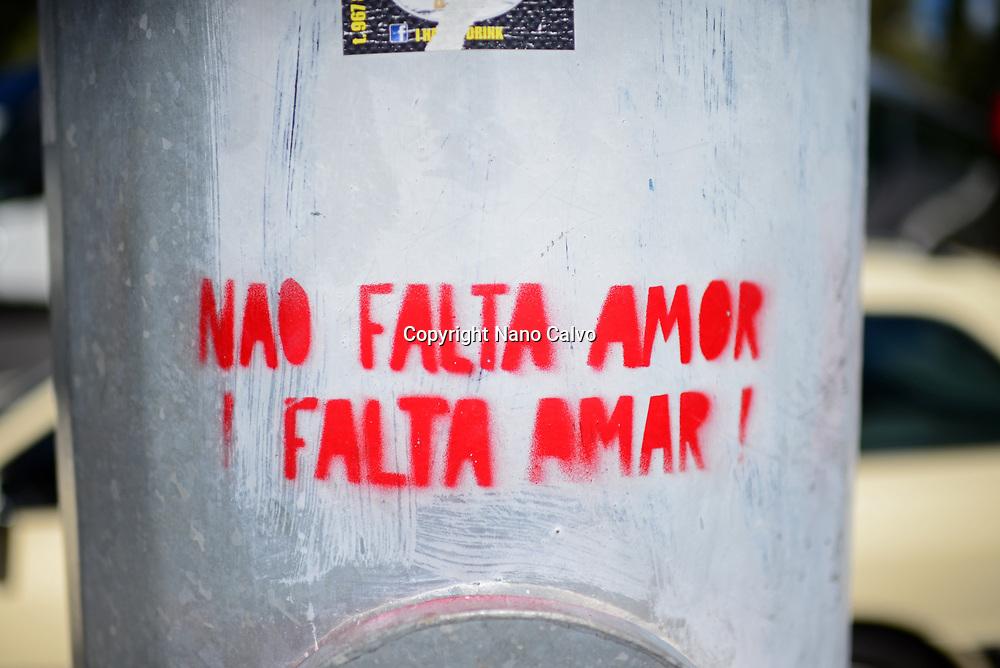 "Street painting reads ""Nao falta amor, Falta Amar"", Belem, Lisbon"