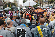 Festival supporters bow in prayer at the end of the Kanamara festival for the steel phallus in Kawasaki Daishi, Kanagawa, Japan. Sunday April 5th 2015 The Kanamara penis festival celebrates a legend about the defeat of a penis-eating demon. It is a wildly popular festival attracting large numbers of locals and foreigners.