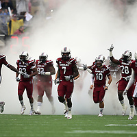 South Carolina Gamecocks defensive end Jadeveon Clowney (7) and the rest of the team is seen during the introductions to the NCAA Capital One Bowl football game between the South Carolina Gamecocks who represent the SEC and the Wisconsin Badgers who represent the Big 10 Conference, at the Florida Citrus Bowl on Wednesday, January 1, 2014 in Orlando, Florida. (AP Photo/Alex Menendez)