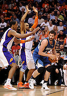 Mar. 12, 2012; Phoenix, AZ, USA;  Minnesota Timberwolves forward Kevin Love (42) handles the ball against the Phoenix Suns forward Channing Frye (8) and forward Grant Hill (33) during the first half at the US Airways Center.  The Timberwolves defeated the Suns 127-124.  Mandatory Credit: Jennifer Stewart-US PRESSWIRE.