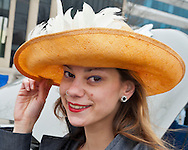March 31, 2013 - Garden City, New York, U.S. - JENNY MOSCO, of Plainview, shows off her straw and feather Easter Bonnet at the 58th Annual Easter Sunday Vintage Car Parade and Show sponsored by the Garden City Chamber of Commerce. Hundreds of authentic old motorcars, 1898-1988, including antiques, classic, and special interest participated in the parade.
