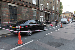 © Licensed to London News Pictures. 25/07/2017. LONDON, UK.  Police officers at the crime scene cordon on Burnham Street just off Roman Road this evening near Singh supermarket.  Two males in their late teens have been taken to hospital for treatment after an unknown liquid was thrown at them. Photo credit: Vickie Flores/LNP