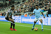 Raheem Sterling (#7) of Manchester City takes on Jacob Murphy (#7) of Newcastle United during the Premier League match between Newcastle United and Manchester City at St. James's Park, Newcastle, England on 27 December 2017. Photo by Craig Doyle.