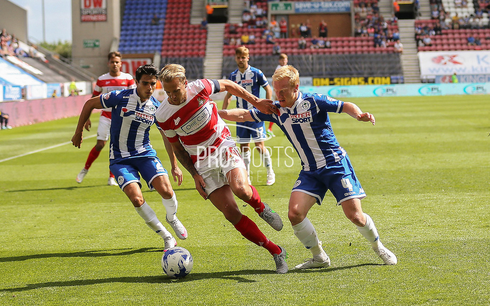 James Coppinger during the Sky Bet League 1 match between Wigan Athletic and Doncaster Rovers at the DW Stadium, Wigan, England on 16 August 2015. Photo by Simon Davies.
