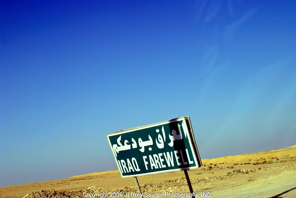 A sign bids farewell on one side and welcome on the other in Al Quim, Iraq, as the Al-kasid family finally clears the Syrian-Iraqi border at about 8:30a.m. Sunday, July 20, 2003. The family is travelling back to its home city of Nassiriyah, Iraq, for the first time since 1991 after fighting in the failed uprising against Saddam Hussein, fleeing to a refuge camp in Saudi Arabia for 3 years and finally settling in Dearborn, MI.