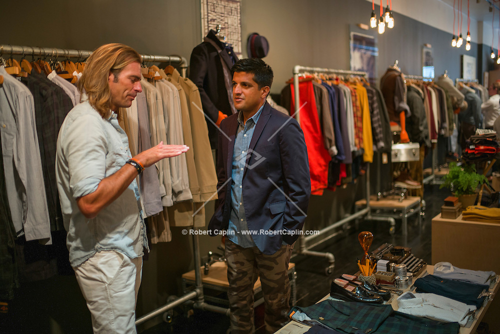 NEW YORK, NY (09.04.2013) Documenting the opening of a Dockers pop up store in Lower Manhattan. This is for a story about the process behind opening up a pop up store for fashion week. Pictured, Maneesh Goyal, the 38 year-old founder of MKG, right speaking with Doug Conklin - SVP of design Dockers, left.<br /> <br /> (Photo by Robert Caplin)