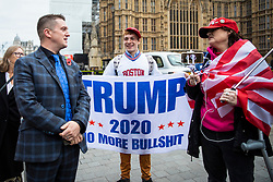 © Licensed to London News Pictures. 06/11/2018. London, UK. Right-wing activist Tommy Robinson (L) speaks with Donald Trump supporters in Westminster. Photo credit: Rob Pinney/LNP
