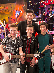 Danny O'Donoghue makes a suprise visit to the Late Late Toy show pictured with The Superheroes from Galway Adam Kerrigan (11) from Galway, Finn Fitzgerald (11) from Meath and Stephen Dungan (11) from Meath. Picture Andres Poveda