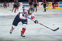 KELOWNA, CANADA - OCTOBER 11: Zane Jones #26 of Lethbridge Hurricanes takes a shot during warm up against the Kelowna Rockets on October 11, 2014 at Prospera Place in Kelowna, British Columbia, Canada.   (Photo by Marissa Baecker/Shoot the Breeze)  *** Local Caption *** Zane Jones;