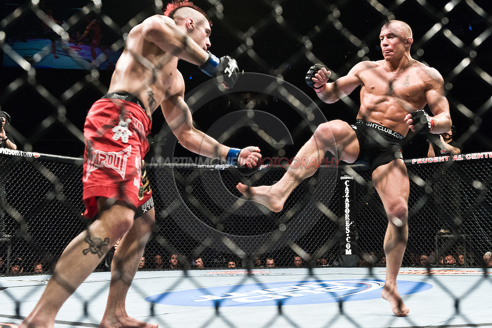 """NEWARK, NEW JERSEY, MARCH 27, 2010: Georges St. Pierre and Dan Hardy are pictured during their bout at """"UFC 111: St. Pierre vs. Hardy"""" in the Prudential Center, New Jersey on March 27, 2010"""