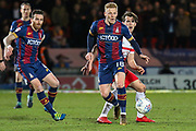 Bradford City midfielder Callum Guy wins the ball from Doncaster Rovers forward John Marquis during the EFL Sky Bet League 1 match between Doncaster Rovers and Bradford City at the Keepmoat Stadium, Doncaster, England on 19 March 2018. Picture by Aaron  Lupton.