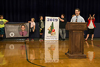 Keith Noyes stands at the podium after being named 2019 Teacher of the Year at Belmont Middle School on Wednesday morning.  (Karen Bobotas/for the Laconia Daily Sun)