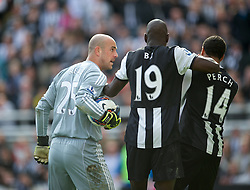 NEWCASTLE-UPON-TYNE, ENGLAND - Sunday, April 1, 2012: Liverpool's goalkeeper Jose Reina leans his head into Newcastle United's James Perch (hidden) which leads to his sending off during the Premiership match at St James' Park. (Pic by David Rawcliffe/Propaganda)