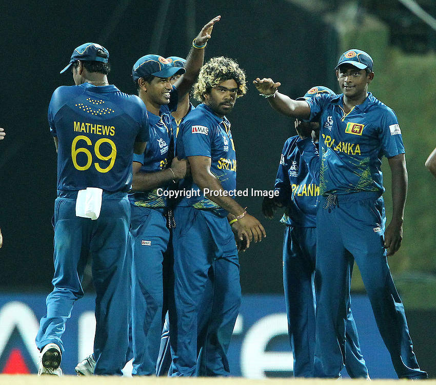 Lasith Malinga celebrates the wicket of Jos Buttler of England  during the ICC World Twenty20 Super Eights match between England and Sri Lanka held at the  Pallekele Stadium in Kandy, Sri Lanka on the 1st October 2012<br /> <br /> Photo by Ron Gaunt/SPORTZPICS