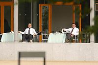 29 JUN 2003, NEUHARDENBERG/GERMANY:<br /> Wolfgang Clement (L), SPD, Bundeswirtschaftsminister, und Gerhard Schroeder (R), SPD, Bundeskanzler, beim gemeinsamen Fruestueck auf der Terasse, Klausurtagung des Bundeskanbinetts, Schloss Neuhardenberg, Brandenburg<br /> IMAGE: 20030629-01-014<br /> KEYWORDS: Kabinett, Sitzung, Klausur, Kabinettsklausur, Schloß Neuhardenberg, Gerhard Schröder