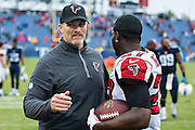 NASHVILLE, TN - OCTOBER 25:  Head Coach Dan Quinn hugs Robenson Therezie #27 of the Atlanta Falcons after a game against the Tennessee Titans at Nissan Stadium on October 25, 2015 in Nashville, Tennessee.  The Falcons defeated the Titans 10-7.  (Photo by Wesley Hitt/Getty Images) *** Local Caption *** Dan Quinn; Robenson Therezie