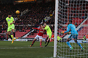 Peterbourgh Ryan Tafazolli (5) heads the ball over the bar 1-0 second half during the EFL Sky Bet League 1 match between Swindon Town and Peterborough United at the County Ground, Swindon, England on 21 January 2017. Photo by Gary Learmonth.