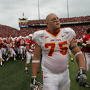 ISU lineman Aaron Brant walks off the field as Nebraska celebrates their 27-20 double overtime victory over the Cyclones.  ISU had the last possesion, but a 4th down pass fell incomplete.  photo by david peterson