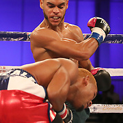 """Christitan """"Macho"""" Camacho throws a right cross to the body of Hector Gonzalez during a Telemundo boxing match at Osceola Heritage Park on Friday, July 20, 2018 in Kissimmee, Florida.  (Alex Menendez via AP)"""