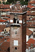 Detail of the Gardello tower viewed from the Lamberti tower, Piazza delle Erbe, Verona, Italy. The Gardello Tower was built in 1370 in brick by Cansignorio della Scala. The apex was added in 1626. Picture by Manuel Cohen.