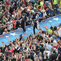 NASCAR drivers Martin Truex Jr.  (l) and Austin Dillon are introduced prior to the 56th Annual NASCAR Daytona 500 race at Daytona International Speedway on Sunday, February 23, 2014 in Daytona Beach, Florida.  (AP Photo/Alex Menendez)