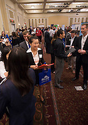 """College of Business students talk and listen to various representatives at Thursday's """"Meet the Accountants"""" event in Baker Center ballroom. Photo by Katelyn Vancouver"""