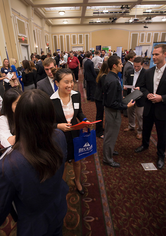 "College of Business students talk and listen to various representatives at Thursday's ""Meet the Accountants"" event in Baker Center ballroom. Photo by Katelyn Vancouver"