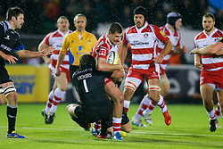 Gloucester Inside Centre Mark Atkinson is tackled by Newcastle Prop Rob Vickers - Photo mandatory by-line: Rogan Thomson/JMP - 07966 386802 - 21/11/2014 - SPORT - RUGBY UNION - Newcastle upon Tyne, England - Kingston Park - Newcastle Falcons v Gloucester Rugby - Aviva Premiership.