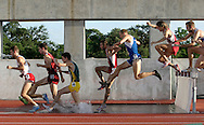 Competitors run the mens' 3,000 meter steeplechase during the NCAA Outdoor Track & Field Championships in Austin on June 12, 2004.