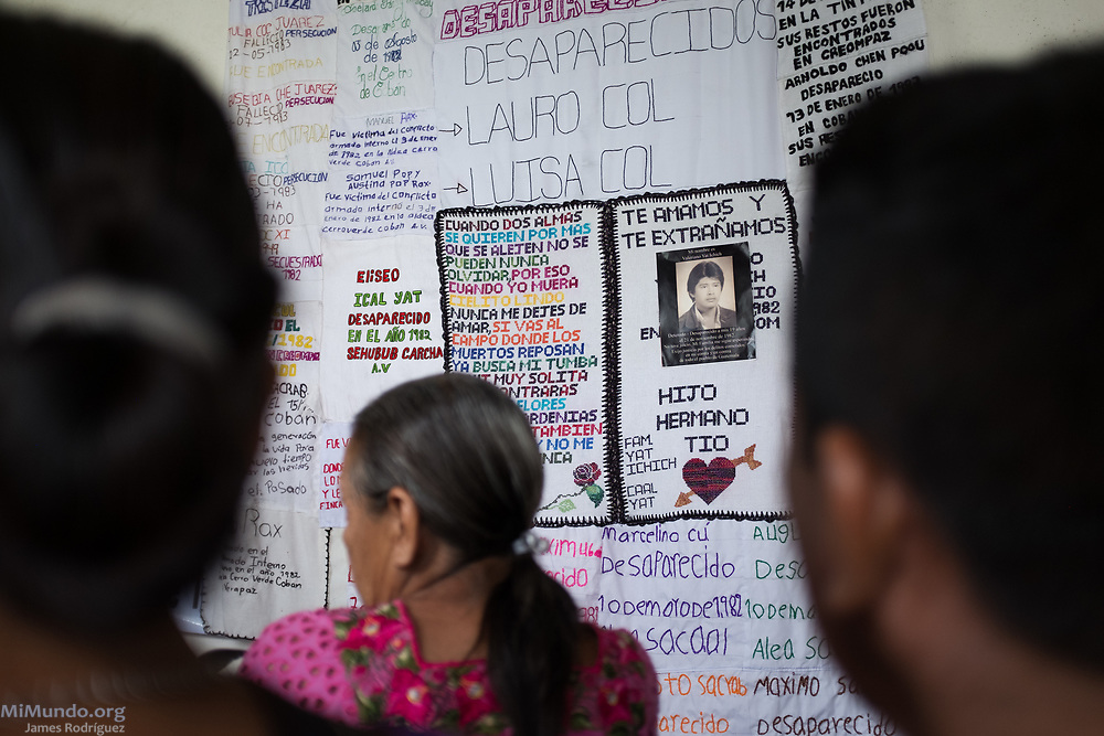 Wartime victims and their kin gather for an event in Coban commemorating the National Day Against Forced Disappearances. In the background, a quilt displays the names of and messages to a handful of the more than 200,000 wartime victims. According to human rights groups, roughly 45,000 people were victims of forced disappearance by State forces during the 36 years of war. Coban, Alta Verapaz, Guatemala. June 21, 2017.