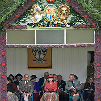 BRAEMAR, UNITED KINGDOM - SEPTEMBER 06: Her Majesty The Queen at the annual Braemar Highland Gathering on September 6, 2008 in Braemar, Scotland. The Braemar Gathering is the most famous of the Highland Games and is known Worldwide. Each year thousands of visitors descend on this small Scottish village on the first Saturday in September to watch one of the more colourful Scottish traditions. The Gathering has a long history and in its modern form it stretches back nearly 200 years.