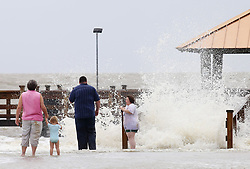 June 21, 2017 - Gulfport, MS, USA - Kathy Majors and her granddaughter, Chloe Schlunaker, 2, and her parents, Justin and Heather Schlunaker of D'Iberville, watch as waves crash against the shore at Moses Pier in Gulfport on Wednesday, June 21, 2017 as Tropical Storm Cindy moved through the area. The family recently moved to the coast from Laurel and wanted to see the storm up close. (Credit Image: © John Fitzhugh/TNS via ZUMA Wire)