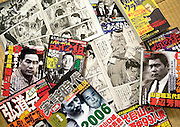 "Yakuza-related magazines and comics lie on the floor at the home of Jake Adelstein, a former reporter at Japan's largest daily newspaper, Yomiuri Shimbun, author of ""Tokyo Vice""  at an undisclosed location in Japan on Aug. 29, 2008. In 2005 American Adelstein uncovered a scandal involving senior members of Japan's mafia, the yakuza, visiting a medical center in Los Angeles to undergo liver transplants, despite being bared from entry due to having criminal records or suspected affiliation with Japanese organized crime groups. Within days, however, Adelstein was visited by mob members and told to either ""erase the story or be erased."" He took the former option and resigned from the Yomiuri, though a recent leak of his story has pushed Adelstein and his family into hiding..Photographer: Robert Gilhooly"