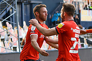 Luton Town midfielder Jordan Clark (18) scores a goal and celebrates with Luton Town defender (on loan from Sheffield United) Rhys Norrington-Davies (24) who supplied the cross 2-1 during the EFL Sky Bet Championship match between Luton Town and Derby County at Kenilworth Road, Luton, England on 19 September 2020.