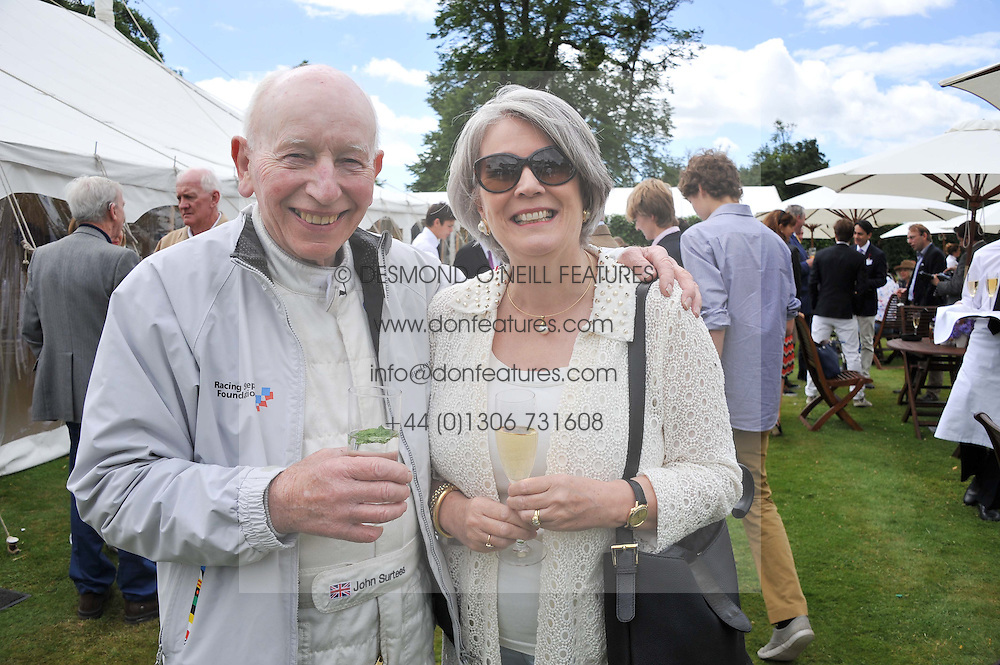 JOHN SURTEES and his wife JANE at a luncheon hosted by Cartier for their sponsorship of the Style et Luxe part of the Goodwood Festival of Speed at Goodwood House, West Sussex on 1st July 2012.