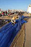 Fixing the nets on free day. Fishermen port, Tangier