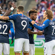 PARIS, FRANCE - September 10: Goalscorer Kingsley Coman #11 of France is congratulated by Antoine Griezmann #7 of France and team mates after scoring his sides first goal during the France V Andorra, UEFA European Championship 2020 Qualifying match at Stade de France on September 10th 2019 in Paris, France (Photo by Tim Clayton/Corbis via Getty Images)
