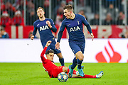 Tottenham Hotspur midfielder Giovani Lo Celso (18) reacts to the decision of a foul against him during the Champions League match between Bayern Munich and Tottenham Hotspur at Allianz Arena, Munich, Germany on 11 December 2019.