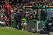 Celtic Manager Neil Lennon scrambles for the ball during the Europa League match between Celtic and Rennes at Celtic Park, Glasgow, Scotland on 28 November 2019.