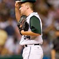 Tampa Bay Devil Rays pitcher Chad Orvella adjusts his cap after walking the New York Yankees' Jason Giambi scoring the Yankee's Gary Sheffield during the seventh inning of their American League baseball game on Thursday, May 4, 2006 in St. Petersburg, Fla.(AP Photo/Scott Audette)